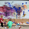 John Cross<br /> Young artists try their hand at painting during a play day Friday at Rasmussen Woods.