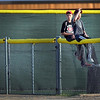 A pair of boys sit on the right field fence to get a better view of Tuesday's Mankato MoonDogs game against Alexandria at Franklin Rogers Park.