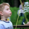John Cross<br /> Alex Doust blows bubbles at a play and child development day sponsored by Minnesota State University Family Consumer Science students Friday at Rasmussen Woods.