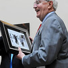 John Cross<br /> Former Vice President Walter Mondale smiles after being presented with a photograph of him greeting Mayor Herb Mocol during a visit to Mankato in 1980. Mondale returned to Mankato Friday for the dedication of the newly remodeled Orness Plaza.