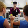 John Cross<br /> Judy Simonsen serves up lunches to youngsters at Hoover Elementary School.