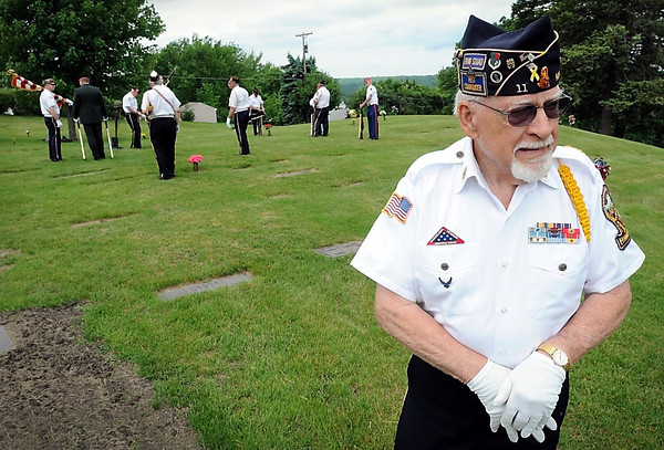 John Cross<br /> Dick Fisk awaits the arrival of a funeral procession as members of the Mankato Memorial Squad get into position. It was the thousandth funeral Fisk had participated in as a member of the squad.