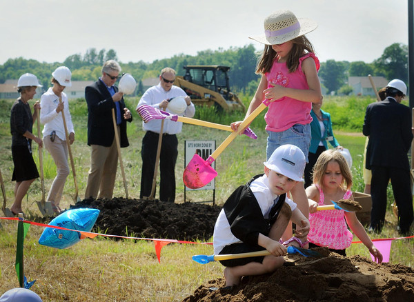 John Cross<br /> Youngsters attending a ground-breaking on Tuesday for a new Mankato Clinic Children's Health Center dug in early as adults in the background prepared to toss a few ceremonial shovels of dirt. The new facility will be located at the  Wickersham Health Campus on Premier Drive.