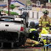 John Cross<br /> Crews work to extricate the driver of an SUV that overturned after being struck broadside by a mini-van at the intersection  of Second Street and Main Street near the Veterans Memorial Bridge at about 12:30 p.m., Saturday.