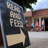 John Cross<br /> Kids head to the St. Peter High School cafeteria Tuesday to participate in a Read and Feed summer reading program.