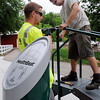 John Cross<br /> Gavin Kitzman (left) and Jason Swygman of E3 Services, a playground equipment installation company, assemble a mobility station, one of several exercise machines installed recently in Sibley Park.