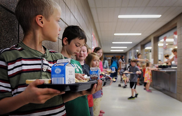 John Cross<br /> Orange chicken and rice was the featured entree for youngsters participating in the summer reading program Read and Feed at the St. Peter High School cafeteria on Tuesday.