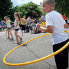 John Cross<br /> Anthony Lowe and other youngsters Hula-hoop to the band during Thursday's Songs on the Lawn.