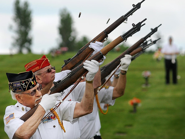 John Cross<br /> Dick Fisk (front) fires a volley during a recent veteran's funeral. It was the thousandth funeral the 84-year-old Air Force veteran has participated in as a member of the Mankato Memorial Squad.