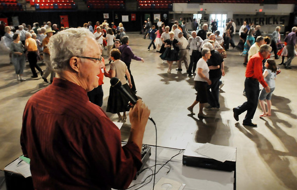John Cross<br /> Chuck Moore of Worthington, Minn., calls for dancers during a dance session at the Verizon Wireless Center.