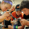 John Cross<br /> Crime sleuths (from left) Lauren Senden, Allison VanderPlas, Daniel Rolding and Jackson Keller dust a water bottle for fingerprints, The youngsters were attending CSI: North Mankato, a program offered through Community Education and Recreation at South Central College this week.