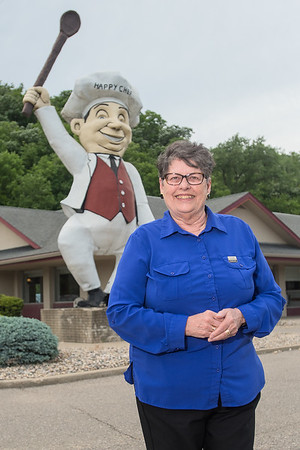 """Kathrine Hughes, a former professor of history at Minnesota State University, is a member of the Heritage Preservation Commission which will hopefully preserve the Happy Chef statue in North Mankato. """"As far as i know this is the last one standing,"""" said Hughes. Photo by Jackson Forderer"""