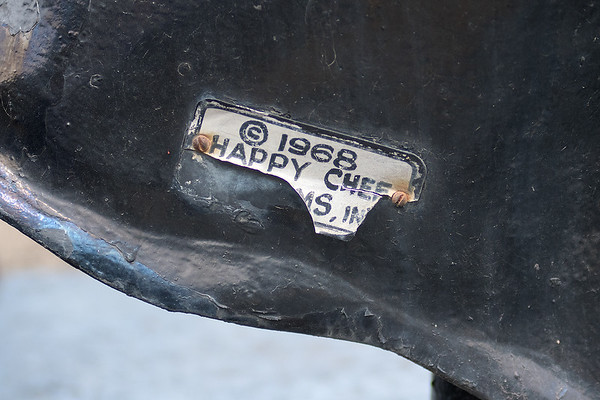 "A deteriorating tag on the Happy Chef's shoe shows the year it was installed, 1968. Kathrine Hughes, a member of the Heritage Preservation Commission, said, ""I noticed that it had come up on 50 years, and for preservation purposes, 50 years is when we start looking at things."" Photo by Jackson Forderer"