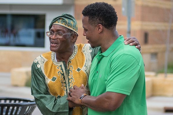 Bukata Hayes (right), Executive Director of the Greater Mankato Diversity Council shakes hands with Michael Fagin (left), a former Ethnic Studies professor at Minnesota State University, as the Juneteenth Celebration march ended in front of the Intergovermental Center on Saturday. Hayes, who is himself a descendent of a slave, and Fagin both gave speeches to those in attendance about the importance of this date in American history. Photo by Jackson Forderer