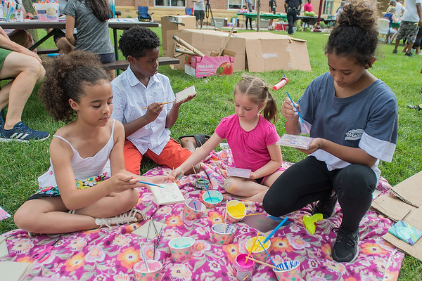 From left, Zuri Hayes, 7, Tyrus Chambers, 9, Elana Nichols, 6, and Laimoni Joseph, 13, paint on ceramic tiles at the first annual Juneteenth Celebration held in front of the Intergovernmental Center on Saturday. Painting was one of many activities at the event celebrating the freeing of slaves from the last plantation on June 19, 1865. The event also included free food, live hip hop performances and community speakers. Photo by Jackson Forderer