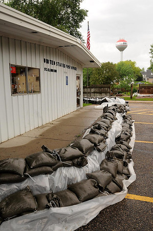 Sandbags surround the St. Clair Post Office to protect it from the nearby Le Sueur River. Photo by John Cross
