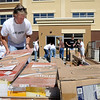 Board members of the Greater Mankato United Way help move materials into the new VINE Faith in Action building in 300  block of North 5th Street on Monday as part of the  United Way National Day of Action. Photo by John Cross
