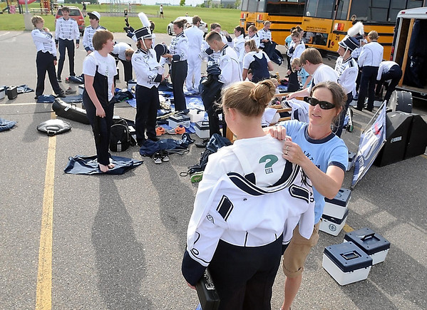 Nia Weiss gets some help with her uniform from her mother Madonna as the rest of the St. Peter Marching Saints get ready for Friday's parade in Lake Crystal. Photo by Pat Christman