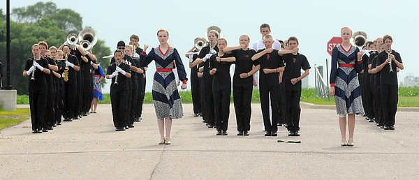 The Mankato Area 77 Lancers marching band warms up before a parade Friday in Lake Crystal. Photo by Pat Christman