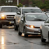 Cars line up along Haefner Drive, the main access to several businesses east of Highway 22 and north of Madison Avenue, on Saturday waiting for the traffic signal at the intersection with Adams Street to change. Photo by John Cross