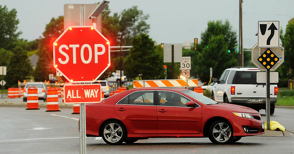 An motorist traveling east on Bassett Drive near Kohls ignores signs prohibiting U-turns in order to get into the west-bound lanes. Photo by John Cross