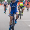 Ruth Winder of Boulder, Colo. raises her fist after crossing the finish line in first place at the North Star Grand Prix. Winder raced with the United Health Care Pro Cycling Team. Photo by Jackson Forderer
