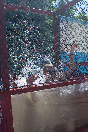 Jimmy Goede falls into the dunk tank in the Express Employment Professionals parking lot on Tuesday. Express Employment Professionals hosted a team of Clydesdales on Tuesday. Photo by Jackson Forderer