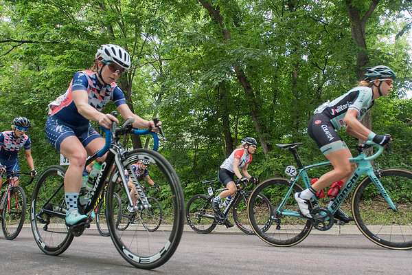 Diedre Ribbons (second from left) with the Orion Racing Team and others in the North Star Grand Prix climb a hill on the race course. Photo by Jackson Forderer