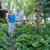Denny and Darlene Albright in one of their backyard gardens in rural Mapleton. Darlene tends her own flower garden and Denny tends his own vegetable garden. The Albrights' gardens are one of the stops on the Maple River Loaves and Fishes Food Shelf garden tour. Photo by Jackson Forderer