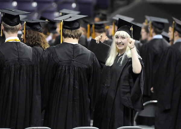 Mankato East graduate Adrien Vader celebrates after receiving her diploma during the school's graduation ceremony Wednesday at Bresnan Arena. Photo by Pat Christman