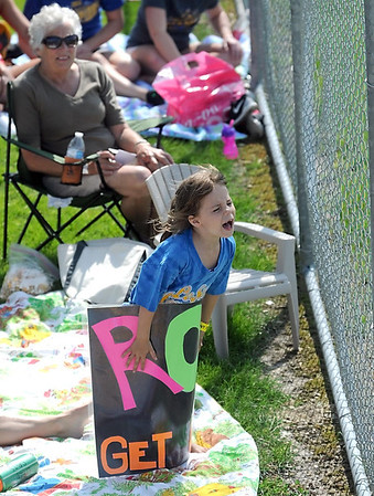 A young fan cheers on the Le Sueur-Henderson softball team during their Class AA quarterfinal game at the State Softball Tournament Thursday at Caswell Park. Photo by Pat Christman