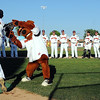 Mankato MoonDogs mascot Muttnik high fives player Logan Gray as the team takes the field for their home opener Wednesday at Franklin Rogers Park. Photo by Pat Christman