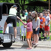 Fourth and fifth graders from Kennedy Elementary School line up to get ice cream from Natalie Hughes' Zip Zap Ice Cream truck during an end of school celebration Wednesday at Ray Erlandson Park.  Photo by Pat Christman