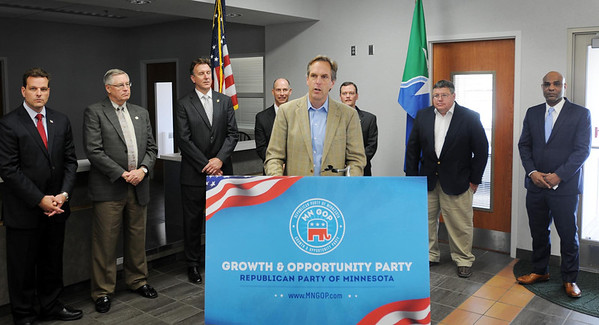 Republican U.S. Senate candidate Mike McFadden talks to supporters during a stop on Tuesday at the Mankato Regional Airport. Pictured behind are fellow Republican candidates, from left: Aaron Miller, 1st Congressional District; Scott Newman, Attorney General; Dan Severson, Secretary of State; Randy Gilbert, State Auditor; Jeff Johnson, Governor and Bill Kuisle, Lt.Governor. At far right is Chris Field, Republican Party deputy chairman. Photo by John Cross