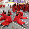Mankato West graduates fit in an impromptu yoga session before the school's graduation ceremony Wednesday at MSU. Photo by Pat Christman