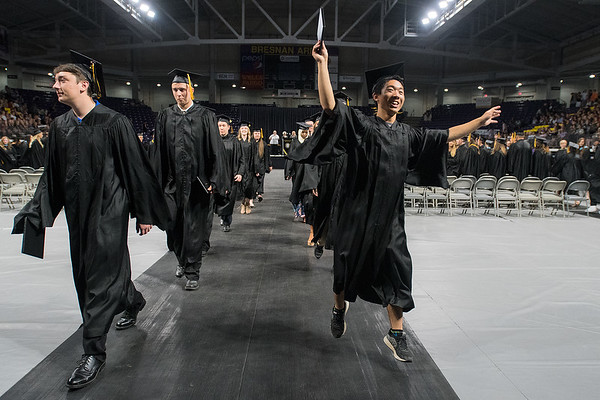 Josh Ouyang (right) dances as Mankato East graduates filed out of Bresnan Arena after commencement ceremonies on Thursday. Photo by Jackson Forderer