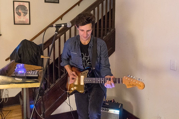 Colin Scharf plays guitar during a Good Night Gold Dust band practice. Photo by Jackson Forderer