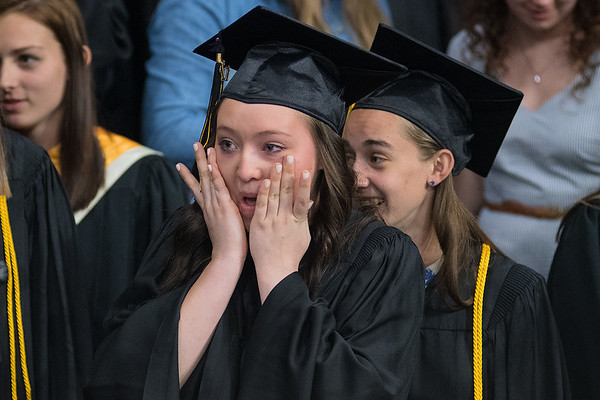 Kyla Modrow wipes tears away from her eyes after singing for the last time with the Mankato East choir during commencement on Thursday at Bresnan Arena. Photo by Jackson Forderer