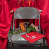 The Mankato West class of 2017 honored the memory of Hannah Oliva by setting aside an empty chair with flowers, a cap and a picture of her. Oliva died in the fall of 2015 during her junior year. Photo by Jackson Forderer