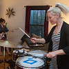 Michelle Roche (right) plays the drums and Laura Schultz (left) plays guitar during a Good Night Gold Dust practice in Schultz's living room. Photo by Jackson Forderer