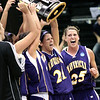 Raymond Starin, special to the Free Press<br /> The Minnesota State women's basketball team holds up the NCAA Division II championship trophy after defeating Franklin Pierce Friday in San Antonio, Texas.