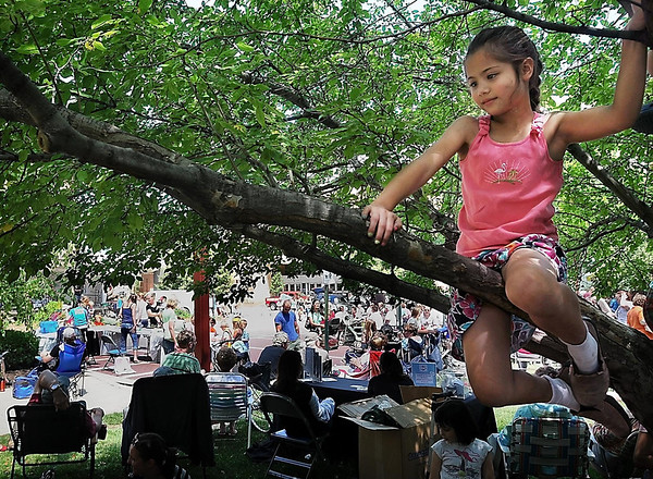 John Cross<br /> Lauren Ingram listened to music at Songs on the Lawn Thursday from her perch in a tree. The Songs on the Lawn continues every Thursday through July 5, in front of the Intergovernmental Center from 11 a.m.-1 p.m.