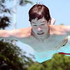 John Cross<br /> Nick Rutten soars from a diving board at Tourellotte Pool on a steamy Wednesday. Tropical dew points and temperatures in the 90s made area pools popular destinations.
