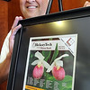 John Cross<br /> Loren Pietsch of North Mankato shows off his winning photograph of pink lady slippers which was selected as the winner of HickoryTech's annual phone book cover contest. Pietsch won $250 and the framed version of the photograph he took in 1993 at Itasca State Park.