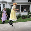 John Cross<br /> Leah Klammer (left) and Isabella Stading lend an air of authenticity to the Lincoln Park Neighborhood Home & Garden Tour Saturday by playing hopscotch outside the house of Maude Hart Lovelace's book character, Tacy, in period dresses.