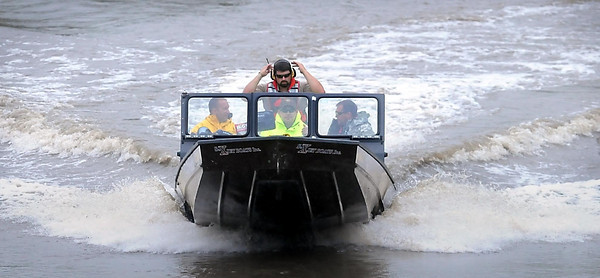 John Cross<br /> A watercraft from the Blue Earth County Sheriff's Department heads upstream from the Courtland access on the rain-swollen Minnesota to resume the search for Stephen Fritze of Watertown, S.D. Fritze is presumed to have drowned while kayaking Saturday with friends.