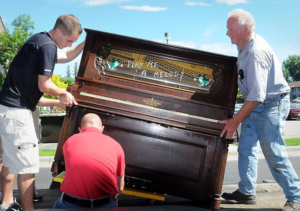 John Cross<br /> Jack McGowan enlisted the help of some youthful muscle from a nearby business at University Square to assist in unloading the piano.