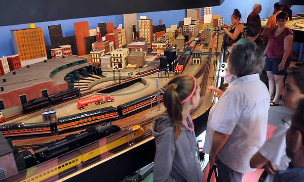 Pat Christman<br /> Visitors watch model trains run through a town at the St. James Model Railroad Club's display Saturday.