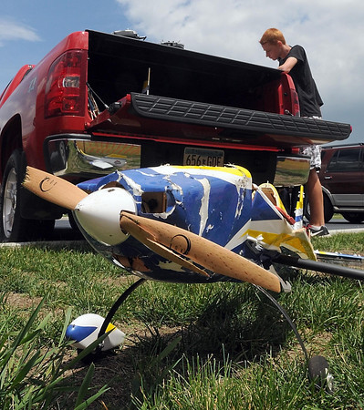 Pat Christman<br /> Alex Schauer loads up the broken hull of his radio controlled airplane after a crash while flying in windy conditions Saturday at Forsberg Field.