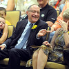 Pat Christman<br /> Retiring South Central College President Keith Stover laughs at a joke as his wife Sandy covers her eyes during a retirement celebration Tuesday at the college.